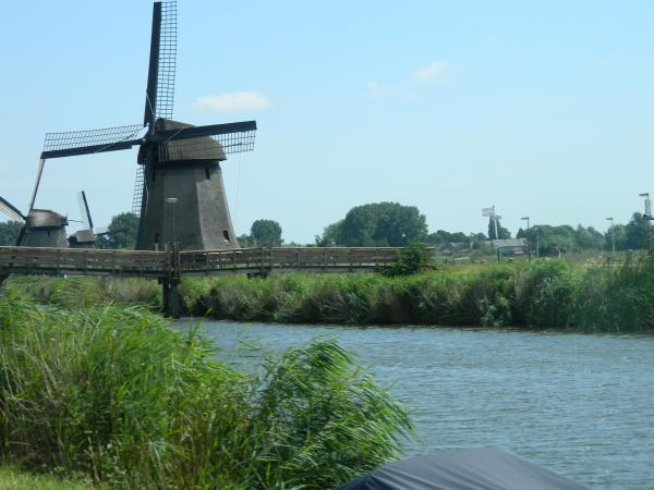 Windmill operating in the Netherlands countryside.