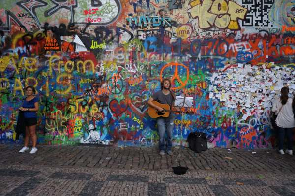 The Lennon Wall (John Lennon).  During communist rule locals painted and hung poetry on this wall only to be covered up everyday by local police.  Locals would continue to paint figures of peace at night and the communist government finally gave up and let the wall be.