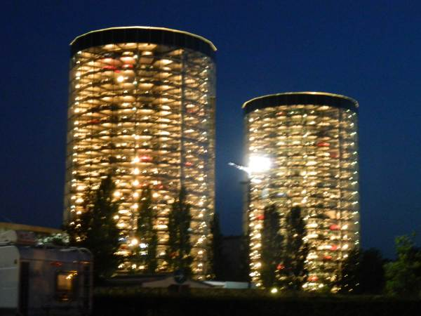 Storage towers lit up at night