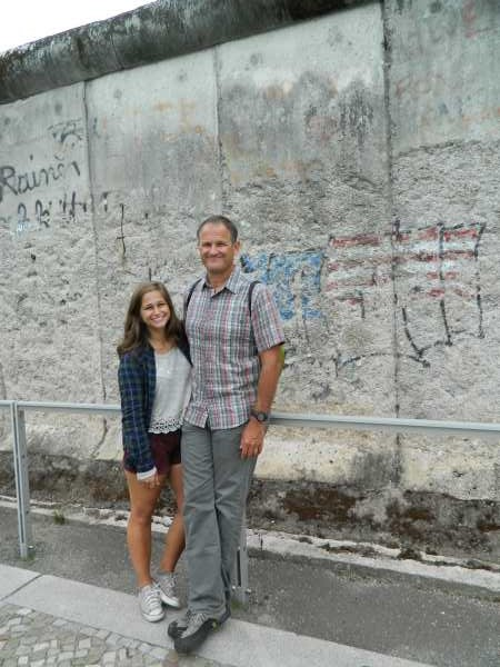 Steve and Giana in front of a remaining piece of the Berlin Wall