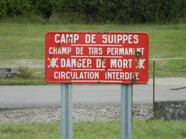 Sign warning people of the dangers of unexploded shells that still remain, 100 years after the war.  The French government estimates there are still millions of unexploded shells remaining,