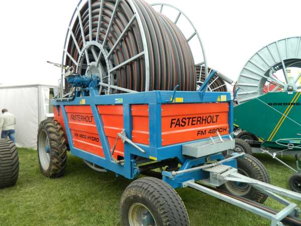 This large hose reel with a water cannon attached to the end appears to be a European irrigation system of choice.  They are very common throughout the countryside and operate similar to the garden sprinkler that pulls its self across the yard.