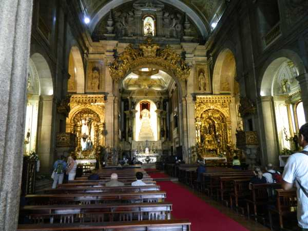 The Gothic architecture of Sao Francis Church with a Baroque interior and lavish use of gold filigree.