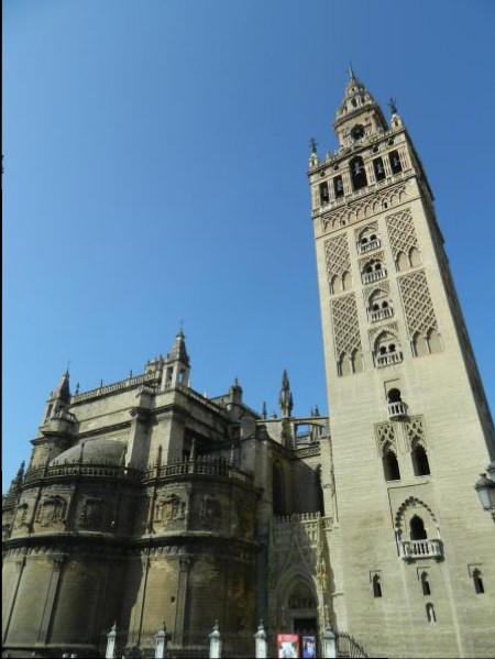 Centered in sivlCathedral and Giralda Bell Tower is the largest Gothic church in the world and contains the tomb of Christopher Columbus.