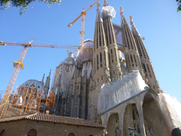 Sagrada Família, started in 1882 is still not complete.  Notice the three cranes working amongst the hordes of tourists.